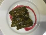 lentil stuffed vine leaves with sour pomegranate reduction
