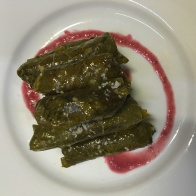 lentil stuffed vine leaves with sour pomegranate reduction