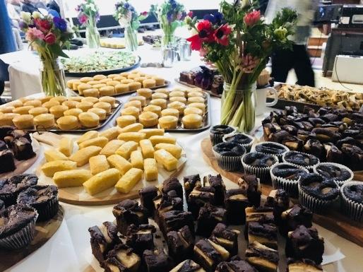 Chocolate pear, lemon cakes display at catering for Robin Murray's memorial