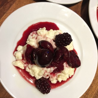 Rice pudding, baked cherries and berries