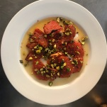 Carousel London - Caramelised Grapefruit, pistachios, honey syrup